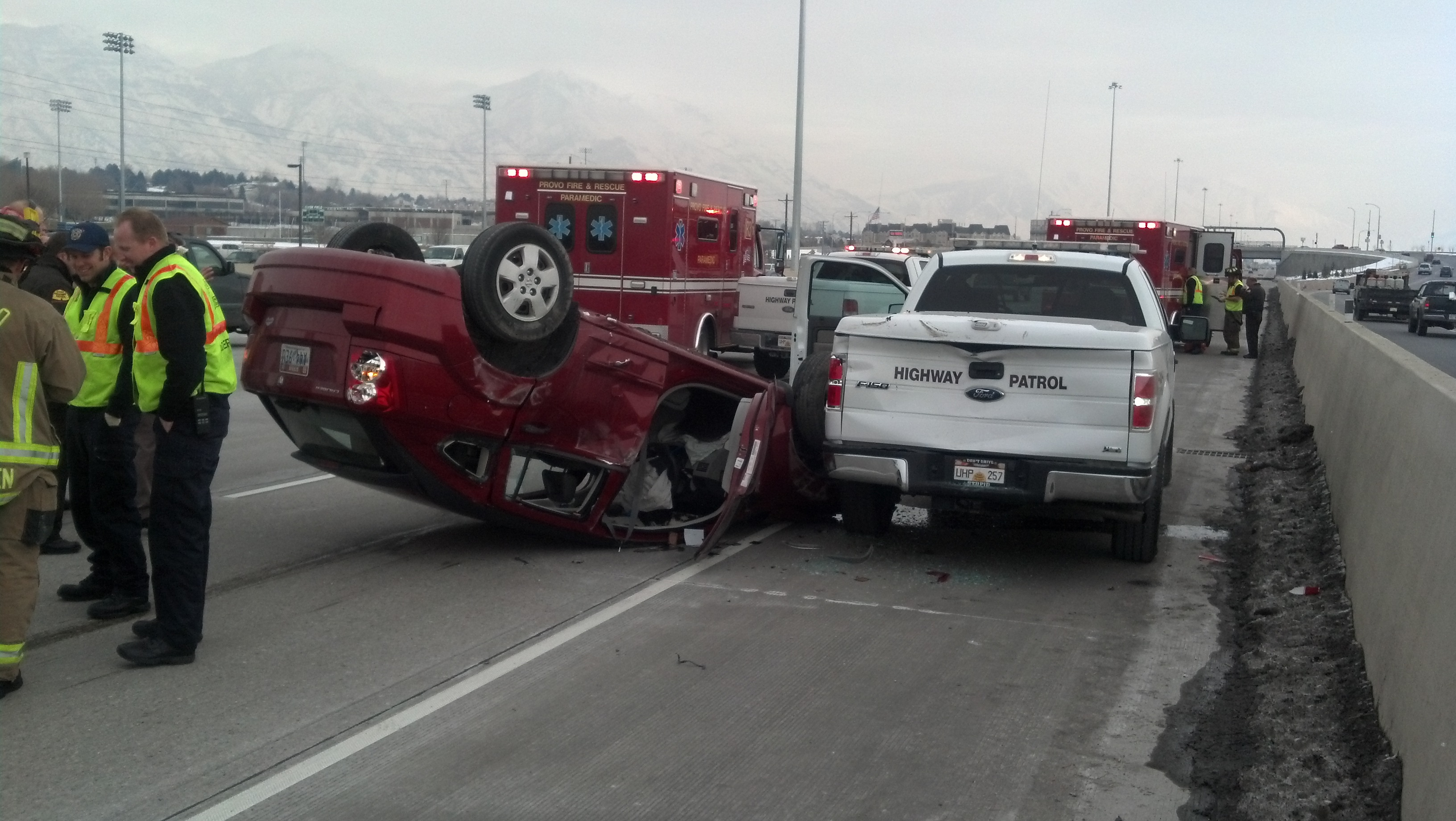 The shoulder of the road is dangerous and can be deadly. Photo shows a car that flipped upside down after striking a UHP vehicle on the shoulder.