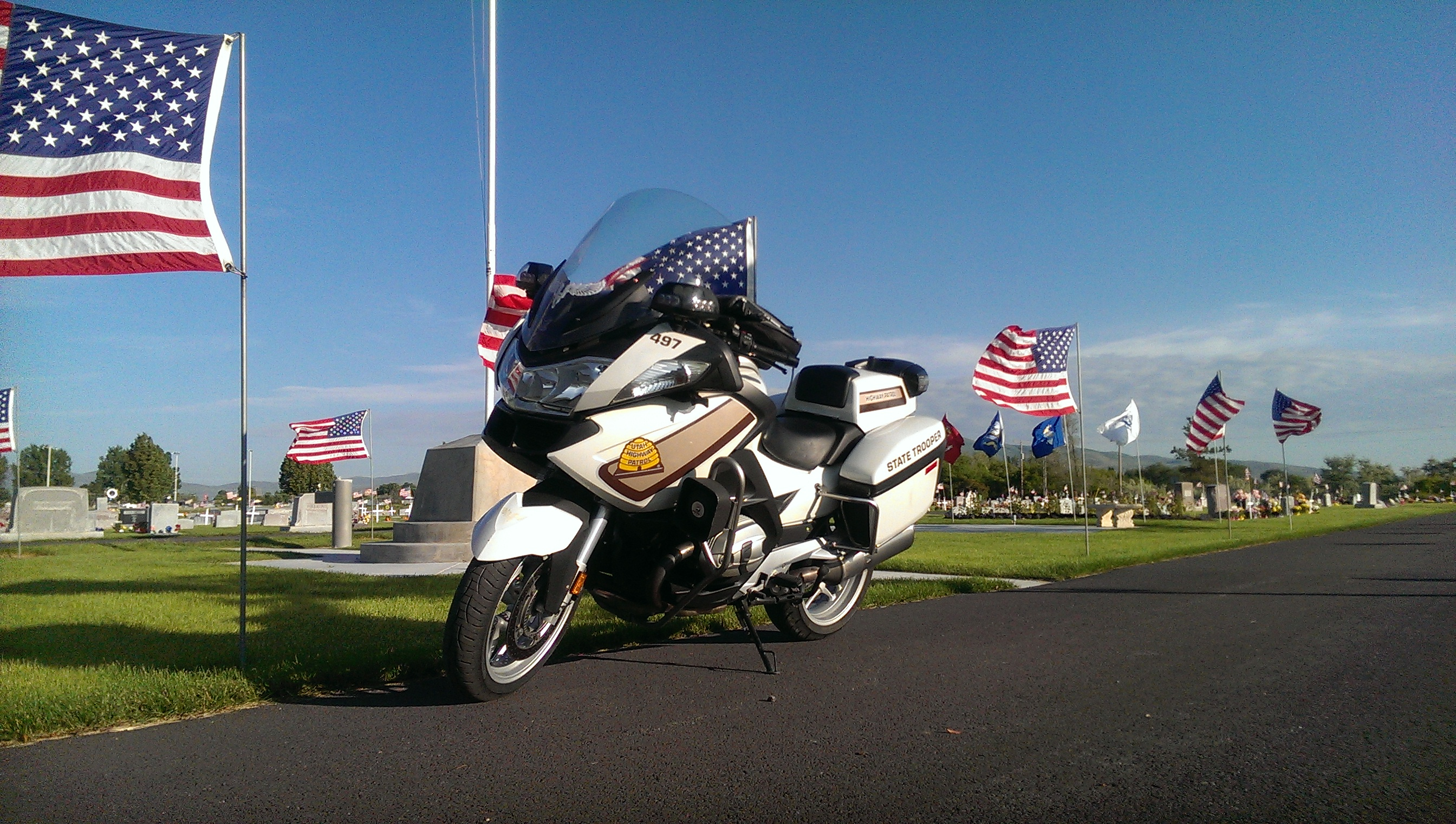 UHP motorcycle parked near flags on Memorial Day 2016