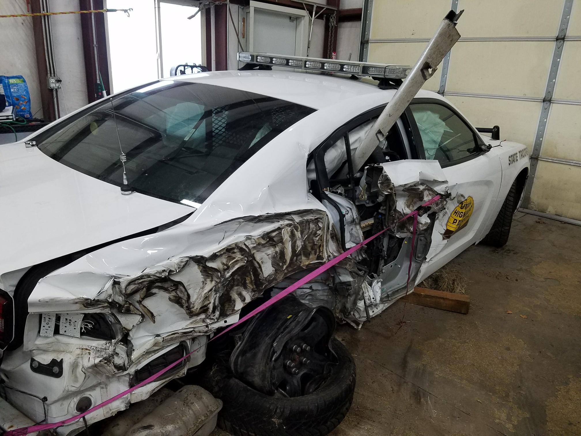 UHP vehicle damaged in road shoulder crash.