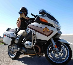 A UHP motor officer aims a lidar detector at oncoming traffic
