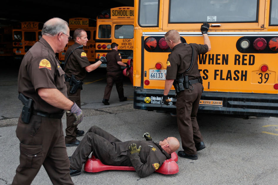 Troopers inspect a school bus for safety certification - photo from Herald Extra
