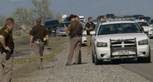 UHP Troopers and SBI agents investigate a body found in a suitcase off I 80