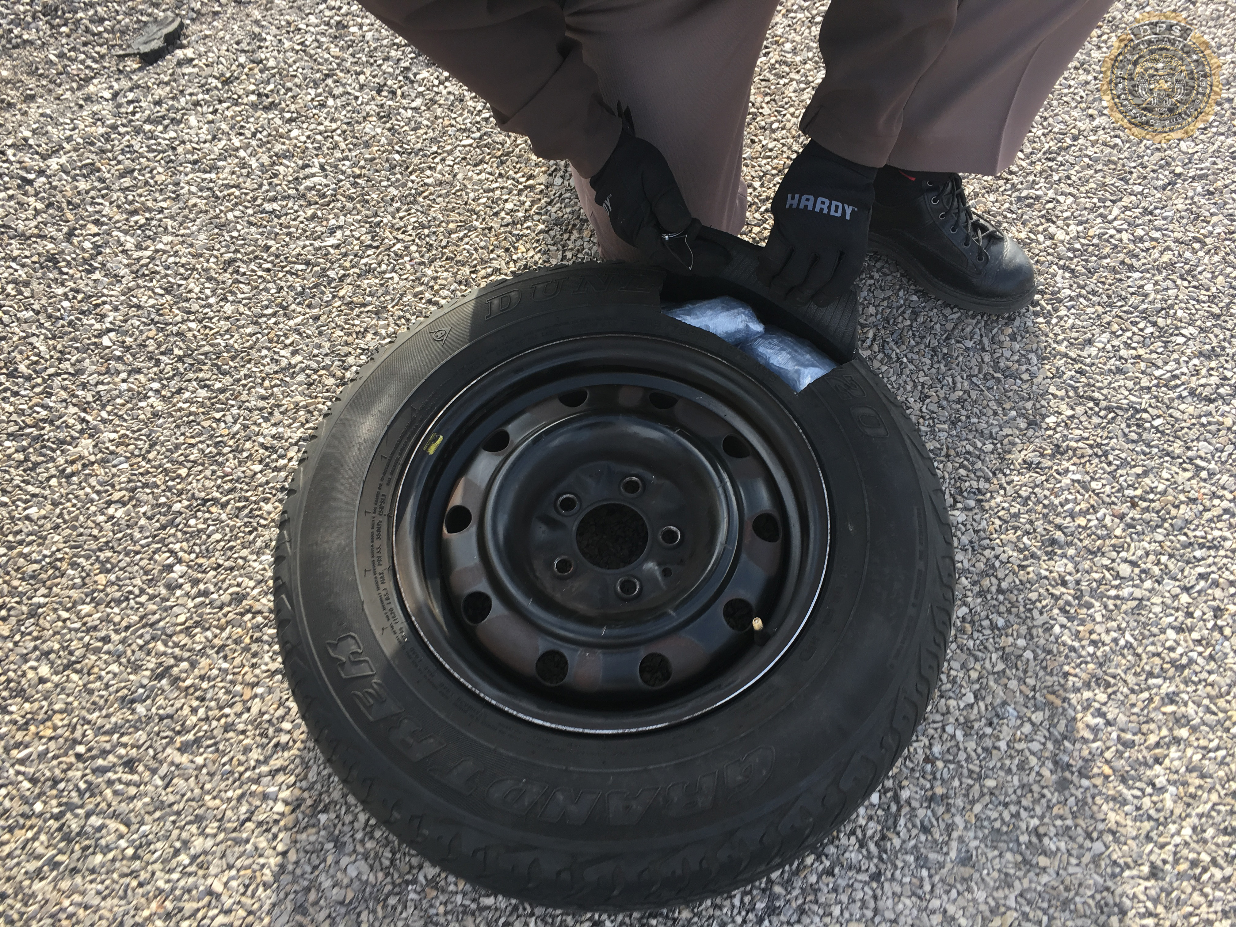 Trooper finds bags of drugs hidden in a spare tire