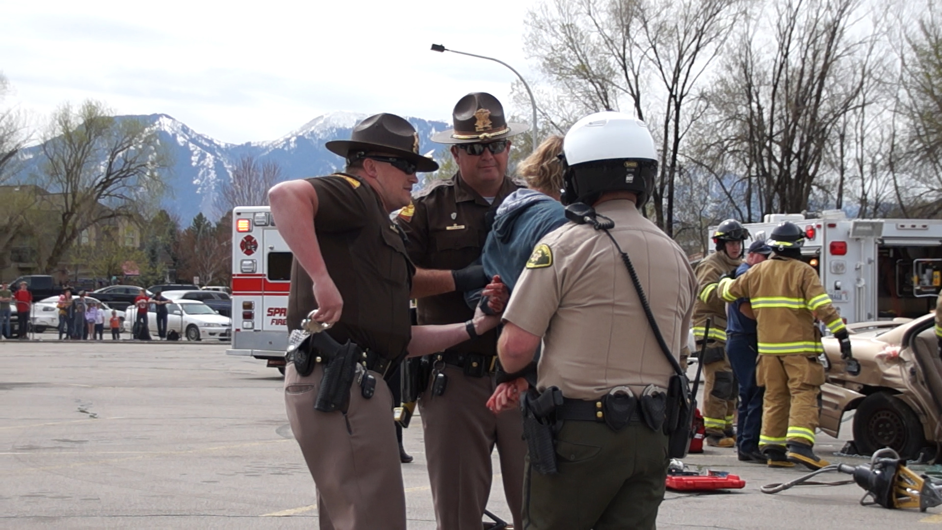 Troopers and Utah County SO Deputy arrest mock crash drunk driver. UHP, Springville PD, SPringville Fire and Rescue, Utah County Sheriff's Office and Lifeflight teamed up to conduct a mock crash at Springville High School on April 10th.
