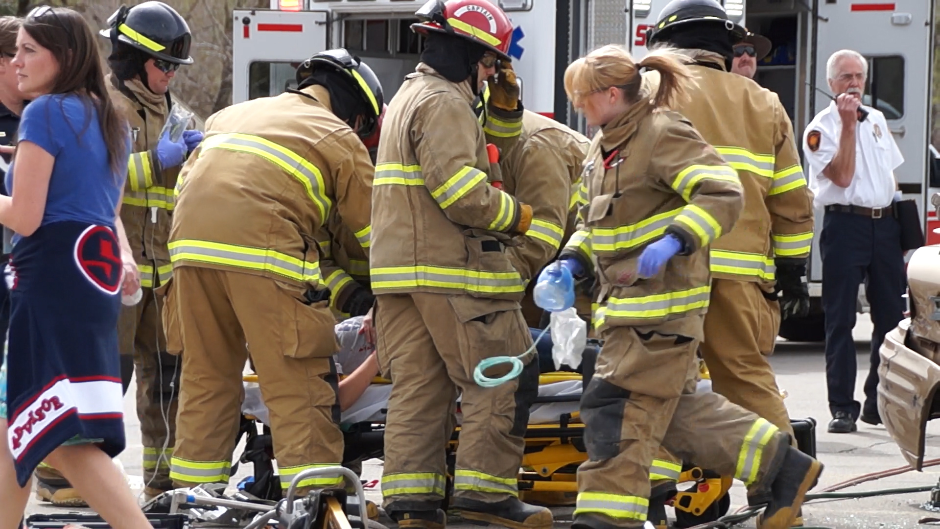 EMTs surround a mock crash victim on a stretcher. UHP, Springville PD, SPringville Fire and Rescue, Utah County Sheriff's Office and Lifeflight teamed up to conduct a mock crash at Springville High School on April 10th.