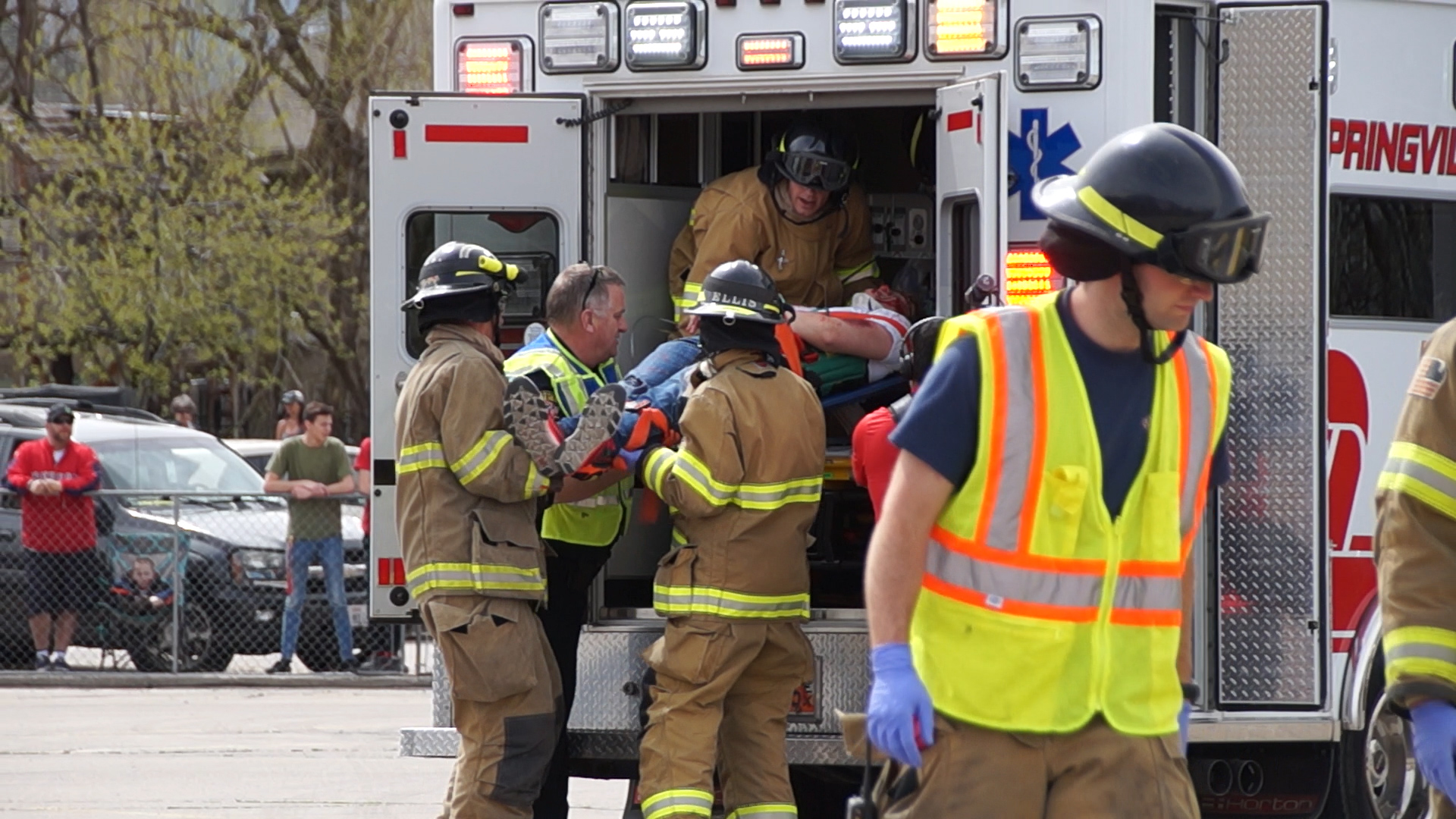 EMTs load mock crash victim into ambulance. UHP, Springville PD, SPringville Fire and Rescue, Utah County Sheriff's Office and Lifeflight teamed up to conduct a mock crash at Springville High School on April 10th.