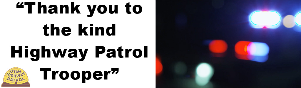 Image shows blurred police car lights and text reads Thank you to the kind Highway Patrol Trooper