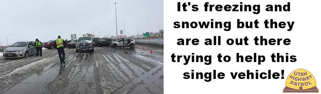 Image shows multiple cars in a crash on a snowy road and It's freezing and snowing but they are all out there trying to help this single vehicle!