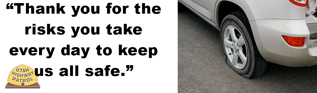 "Image shows a car with a flat rear tire and the text reads ""Thank you for the risks you take every day to keep us all safe."""