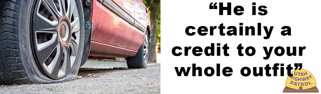 "Image shows a close up of a flat tire on a car and text reads ""He is certainly a credit to your whole outfit."""