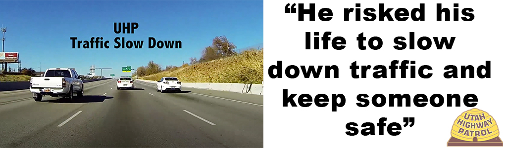 "Image shows a screen cap from a YouTube Video showing a UHP slow down - it's a GoPro capture from the front of a UHP vehicle that shows traffic driving on the 15 in Davis County and the text reads ""He risked his life to slow down traffic and keep someone safe."""