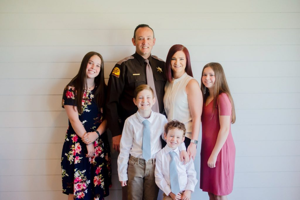 Trooper Eddie Wright poses with his wife and four children
